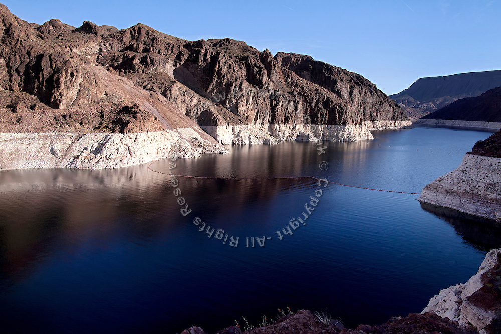 Lake Mead, on the border between Nevada and Arizona, USA, is the main water provider for Las Vegas, a city of 2 million people, in the middle of the southern Nevada desert. A colour shift in the rocks (visible) indicates the water drop the lake has witnessed in recent years. Lake Mead is 180 km long, and when filled to capacity, can reach 28 million acre-feet of water. However, the lake has not reached this capacity in more than a decade, due to increasing droughts.