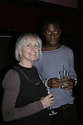 Caroline Baker and Ini Eno-Amooqvaye, Drinks party to launch a new Thomas Pink shirt called The Mogul which has a pocket which houses one's cigar. Hostyed by the Spectator and Thomas Pink. Floridita. Wardour St. London. 1 November 2006. -DO NOT ARCHIVE-© Copyright Photograph by Dafydd Jones 66 Stockwell Park Rd. London SW9 0DA Tel 020 7733 0108 www.dafjones.com