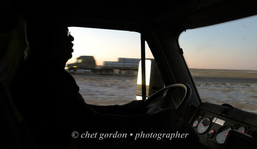 An OTR (Over the Road) driver guides his tractor - trailer along Interstate 70 West in Agate, CO on Friday morning, November 18, 2016. He picked up a load in Perry, GA on Monday and delivered it later at the Pepsi Cola Bottling Co. in Denver.  © Chet Gordon/THE IMAGE WORKS