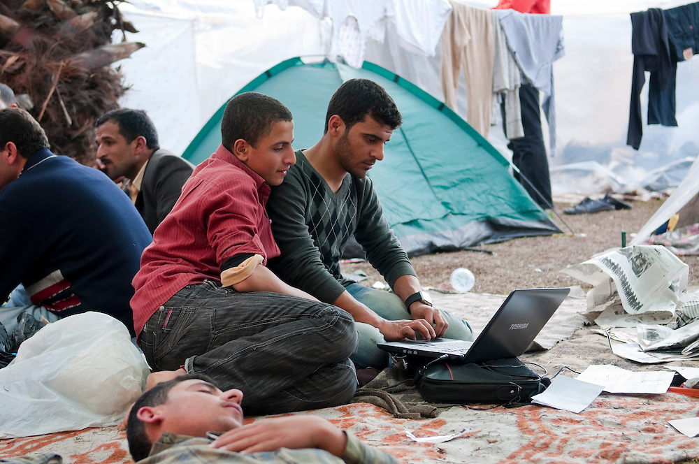 A man works on a Toshiba computer during anti-government demonstrations in Tahrir Square. Social networking and the internet played an important role in the Tahrir Square demonstrations. (Cairo, Egypt - February 9, 2011)