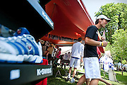Director of Business Development for K-Swiss Bryan Ogle works with enthusiastic Ironman competitors at the K-Swiss stand in the Ironman Village in City Park on Thursday.