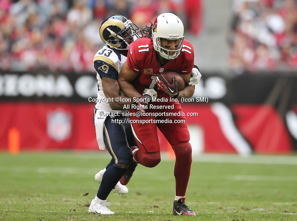 Dec 8 2013: Cardinals WR Larry Fitzgerald (11) tries to run after a catch during the Arizona Cardinals hosting the St. Louis Rams game in the University of Phoenix Stadium in Glendale, AZ.  The Cardinals defeat the Rams 30-10.
