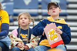 Nov 28, 2015; Morgantown, WV, USA; Young West Virginia Mountaineers fans eat popcorn prior to their game against the Iowa State Cyclones at Milan Puskar Stadium. Mandatory Credit: Ben Queen-USA TODAY Sports