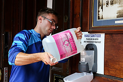 © Licensed to London News Pictures. 03/07/2020. London, UK.  A man fills the hand sanitiser in The Toll Gate, a Wetherspoon pub in north London as the pub prepares to reopen on 4 July, the 'Super Saturday'. Pubs across the UK closed on 23 March following the coronavirus lockdown. As COVID-19 lockdown restrictions are eased, pubs will reopen on Saturday 4 July. Some pubs are planning to reopen from 6am. Photo credit: Dinendra Haria/LNP