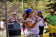 Mackenzie Wolfson plays softball with her counterparts  who are also part of a weight loss program at Camp Shane in the Catskill Mountains, New York. (MacKenzie Wolfson is featured in the What I Eat: Around the World in 80 Diets.)  There are about 500 male and female campers housed in small cabins on shaded hillsides overlooking athletic fields, a small lake, and the camp's most important building, the cafeteria.