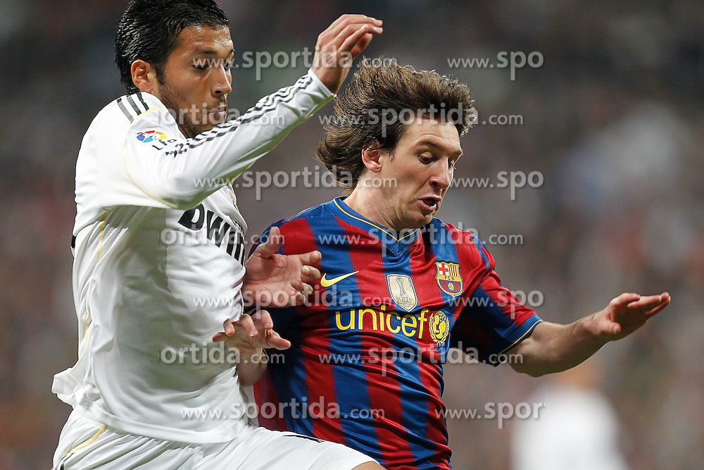 10.04.2010, Estadio Santiago Bernabeu, Madrid, ESP, Primera Division, Real Madrid vs FC Barcelona, im Bild Garay and Messi. EXPA Pictures © 2010, PhotoCredit: EXPA/ Alterphotos/ Cesar Cebolla / SPORTIDA PHOTO AGENCY