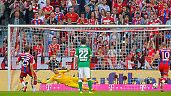 MUNICH, GERMANY - OCTOBER 18: Thomas Muller of Bayern Munich scores a goal from a penalty during the Bundesliga match between Bayern Munich and Werder Bremen. October 18, 2014 in Munich, Germany. Photo mandatory by-line: Mitchell Gunn