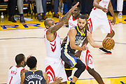 Golden State Warriors guard Stephen Curry (30) passes the ball against the Houston Rockets during Game 4 of the Western Conference Finals at Oracle Arena in Oakland, Calif., on May 22, 2018. (Stan Olszewski/Special to S.F. Examiner)