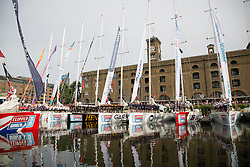 © Licensed to London News Pictures. 01/09/2013. London, UK. Crew members stand on their yachts for the blessing of the Clipper fleet and official departure ceremony. The Clipper 2013-14 Round the World Yacht Race departs from St Katharine Docks on the River Thames. Photo credit : Vickie Flores/LNP