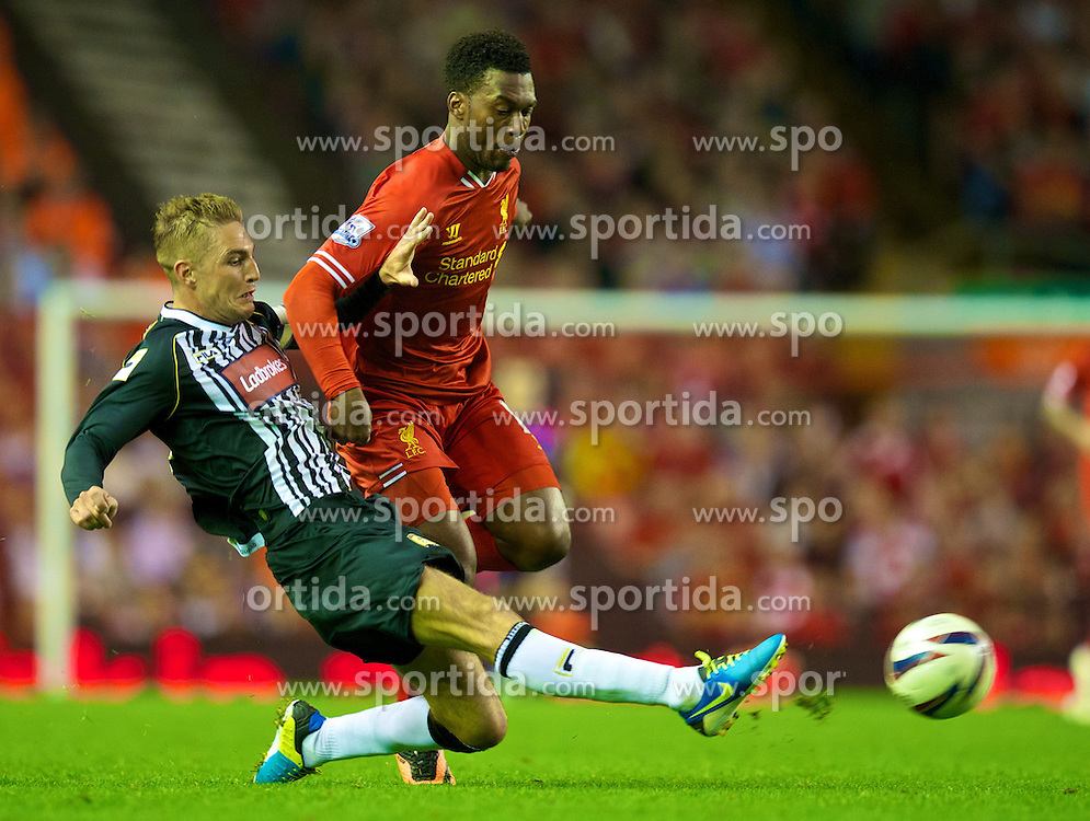 27.08.2013, Anfield, Liverpool, ENG, League Cup, FC Liverpool vs Notts County FC, 2. Runde, im Bild Liverpool's Daniel Sturridge and Notts County's Gary Liddle during the English League Cup 2nd round match between Liverpool FC and Notts County FC, at Anfield, Liverpool, Great Britain on 2013/08/27. EXPA Pictures &copy; 2013, PhotoCredit: EXPA/ Propagandaphoto/ David Rawcliffe<br /> <br /> ***** ATTENTION - OUT OF ENG, GBR, UK *****