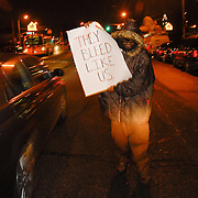 Date: 12/1/06<br /> desk: metro<br /> slug: dorismond<br /> id: 30034277A<br /> <br /> A mourner, who identified himself only as The Revolutionary Rapper, holds a protest sign in the midst of traffic outside of the funeral of Sean Bell, 23, who was killed in a hail of 50 bullets by New York City police officers, at the Community Church of Christ in Queens, New York on December 1, 2006. Bell was killed in the early morning of November 25, 2006 leaving his bachelor party at Club Kalua in Queens, just hours before he as scheduled to marry in the church where his funeral was held.<br /> <br /> photo by Angela Jimenez for The New York Times<br /> photographer contact 917-586-0916