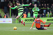 Forest Green Rovers Christian Doidge(9) jumps a tackle from Luton Towns Sheehan during the EFL Sky Bet League 2 match between Forest Green Rovers and Luton Town at the New Lawn, Forest Green, United Kingdom on 16 December 2017. Photo by Shane Healey.