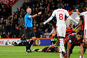 Referee Mike Dean points the penalty spot after Mamadou Sakho (12) of Crystal Palace elbowed Jefferson Lerma (8) of AFC Bournemouth during the Premier League match between Bournemouth and Crystal Palace at the Vitality Stadium, Bournemouth, England on 1 October 2018.