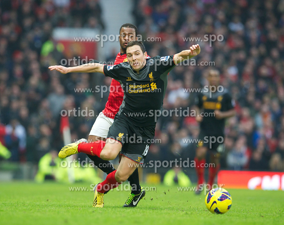 13.01.2013, Old Trafford, Manchester, ENG, Premier League, Manchester United vs FC Liverpool, 22. Runde, im Bild Liverpool's Stewart Downing is hacked down by Manchester United's Patrice Evra during the English Premier League 22th round match between Manchester United and Liverpool FC at Old Trafford, Manchester, Great Britain on 2013/01/13. EXPA Pictures © 2013, PhotoCredit: EXPA/ Propagandaphoto/ David Rawcliffe..***** ATTENTION - OUT OF ENG, GBR, UK *****