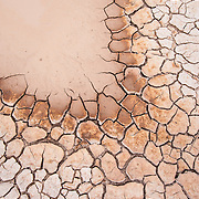 Cracked mud, Badlands National Park, South Dakota, USA.