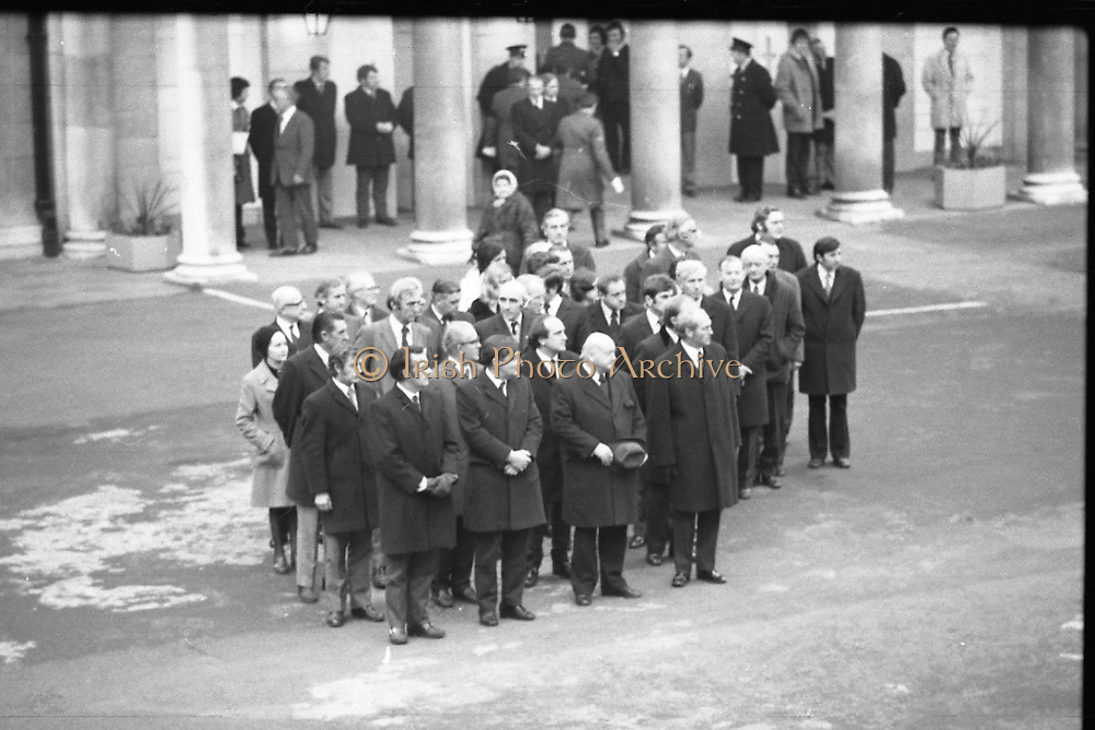 Funeral of President Childers.    (H62)..1974..20.11.1974..11.20.1974..20th November 1974..Following a period of lying in state, the remains of President Erskine Childers were removed today from Dublin Castle. The cortege would transfer the president to St Patrick's Cathedral where the funeral service would be held...Photograph shows family,ministers of state and government ministers waiting to follow the cortege.