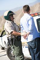 Police officer arresting driver