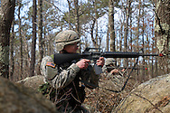 Apr, 9, 2011, Camp Edwards, Massachusetts - Cadet Jon Broderick firs his M16 during an ROTC spring field training exercise. Photo by ©Lathan Goumas.