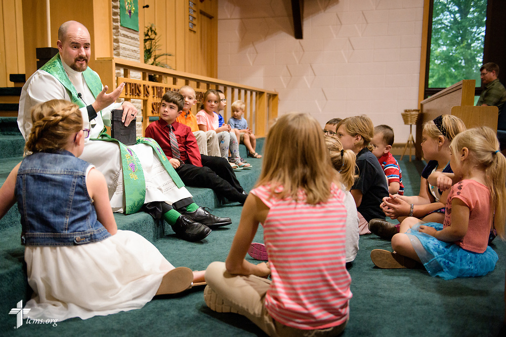 The Rev. Dr. Heath Trampe speaks with children during worship on Sunday, Sept. 24, 2017, at Faith Lutheran Church, York, Neb. LCMS Communications/Erik M. Lunsford