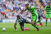 Grimsby Town's Omar Bogleand and Forest Green's Aarran Racine clash during the Conference Premier Final match between Forest Green Rovers and Grimsby Town FC at Wembley Stadium, London, England on 15 May 2016. Photo by Shane Healey.