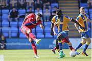 Nathaniel Mendez-Laing shoots during the EFL Sky Bet League 1 match between Shrewsbury Town and Rochdale at Greenhous Meadow, Shrewsbury, England on 8 April 2017. Photo by Daniel Youngs.