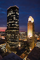 Dramatic view of the Minneapolis skyline at dusk depicting its large skyrise office towers.