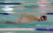 Westford Academy freshman Adam Mullin works his way through the 500 yard freestyle during the DCL meet at Atkinson Pool in Sudbury, Jan. 31, 2015.   (Wicked Local Photo/James Jesson)