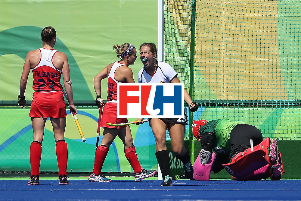 RIO DE JANEIRO, BRAZIL - AUGUST 15:  Marie Mavers #23 of Germany celebrates after scoring a first half goal past goalkeeper Jackie Briggs #31 of United States during the quarter final hockey game on Day 10 of the Rio 2016 Olympic Games at the Olympic Hockey Centre on August 15, 2016 in Rio de Janeiro, Brazil.  (Photo by Christian Petersen/Getty Images)