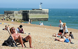 © Licensed to London News Pictures. 18/07/2013<br /> As the heatwave continues across the UK today (18.07.2013)<br /> People enjoy the  heatwave  in Hastings,East Sussex.<br />  Photo credit :Grant Falvey/LNP