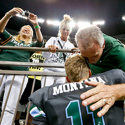 Aug 29, 2013; New Orleans, LA, USA; Tulane Green Wave quarterback Nick Montana (11) is hugged by his father former NFL player Joe Montana as his mom Jennifer Montanta looks on following a win against the Jackson State Tigers at the Mercedes-Benz Superdome. Tulane defeated Jackson State 34-7. Mandatory Credit: Derick E. Hingle-USA TODAY Sports