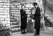 A husband and his wife having a moment waiting for the bus from Jerusalem to Migron to visit the grave of the Rabbi Shimon Bar Yochai for the festivity of Lag BaO'mer.