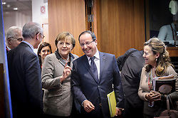 Angela Merkel, Germany's chancellor, and Francois Hollande, France's president, enter the council chambers together, on the first day of the EU Summit, at the European Council headquarters in Brussels, Belgium on Thursday, Dec. 13, 2012. (Photo © Jock Fistick)