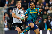 Derby County defender Matthew Clarke challenges for the ball during the EFL Sky Bet Championship match between Derby County and Hull City at the Pride Park, Derby, England on 18 January 2020.