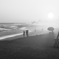 Newport Beach California Lifeguard Tower M sunset black and white panorama photo. Balboa Peninsula is a popular area of Newport Beach along the Pacific Ocean in Orange County Southern California. Panorama photo ratio is 1:3. Copyright ⓒ 2017 Paul Velgos with All Rights Reserved.