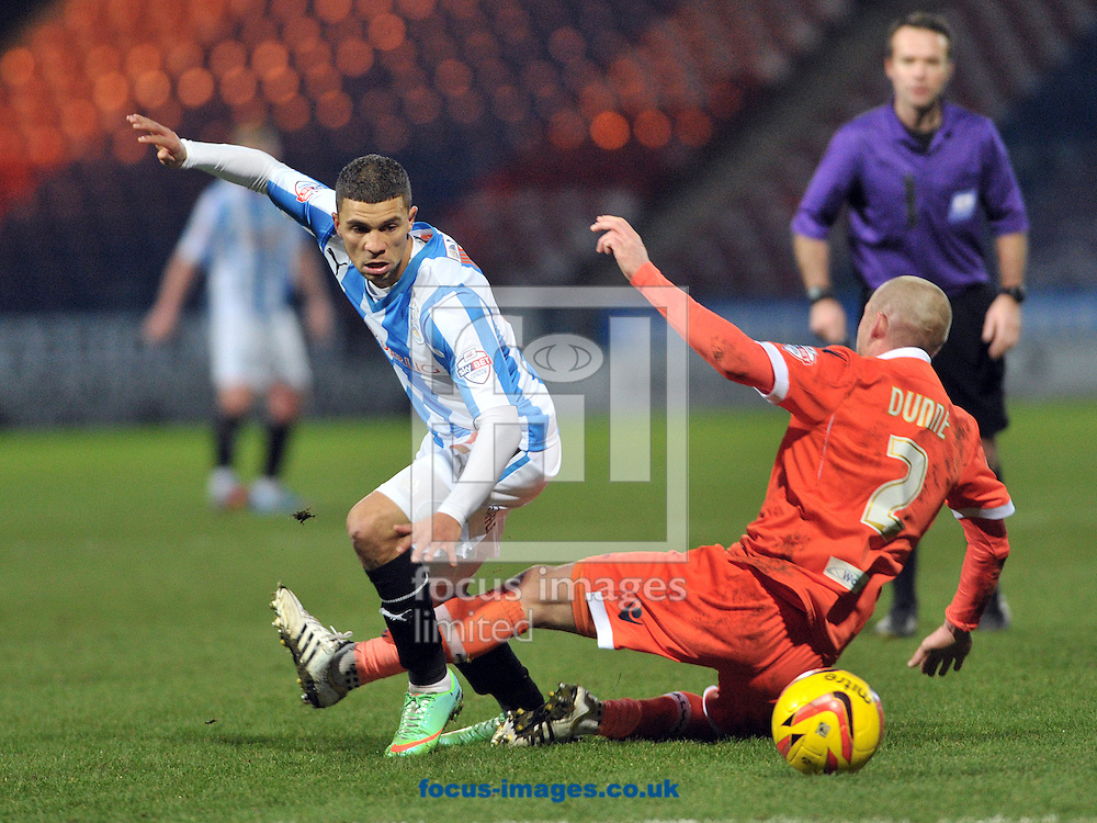 Picture by Graham Crowther/Focus Images Ltd +44 7763 140036<br /> 11/01/2014<br /> Nahki Wells of Huddersfield Town battles with Alan Dunne of Millwall during the Sky Bet Championship match at the John Smiths Stadium, Huddersfield.
