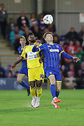 Jake Reeves midfielder for AFC Wimbledon (8) and Tarique Fosu-Henry striker Accrington Stanley (30) jump during  the Sky Bet League 2 Play-Off first leg match between AFC Wimbledon and Accrington Stanley at the Cherry Red Records Stadium, Kingston, England on 14 May 2016. Photo by Stuart Butcher.