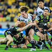 Micheal Little tackled by Finlay Christie during the Super Rugby union game between Hurricanes and Sunwolves, played at Westpac Stadium, Wellington, New Zealand on 27 April 2018.   Hurricanes won 43-15.