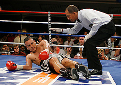 June 20, 2007; New York, NY, USA;  Edgar Santana is knocked down by Harrison Cuello during the 3rd round of their 10 round junior welterweight main event at the Grand Ballroom at the Manhattan Center in New York, NY.  Cuello shocked the favored Santana by 3rd round KO.