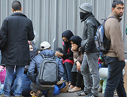 "Migrants stand in street near the Jaures and Stalingrad metro stations, in northern Paris, France, on October 31, 2016, during a police operation aiming at a future evacuation of a migrant camp. An operation of ""administrative control"" was underway on early October 31 in the Jaures/Stalingrad quarter before a future evacuation, whose date has not yet been set, according to a police source. The makeshift camp on the outskirts of the 10th and 19th arrondissements in the north of the capital numbers today 2,500 people, according to the City of Paris Photo by Somer/ABACAPRESS.COM"