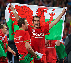 CARDIFF, WALES - Tuesday, October 13, 2015: Wales' Gareth Bale and Chris Gunter celebrate qualifying for the finals following a 2-0 victory over Andorra during the UEFA Euro 2016 qualifying Group B match at the Cardiff City Stadium. (Pic by Ian Cook/Propaganda)