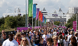 © Licensed to London News Pictures.03/08/2012. London UK. Athletics fans walk to and from the Olympic Stadium, via the Greenway on the first day of competition on the track and field.  Photo credit : Andrew Baker/LNP