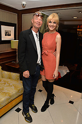 "ANTHONY HICKOX and MADALINA ANEA at a party to celebrate the publication of ""Lady In Waiting: The Wristband Diaries"" By Lady Victoria Hervey held at The Goring Hotel, Beeston Place, London on 9th May 2016."