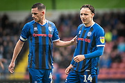 Jimmy McNulty of Rochdale AFC and Oliver Rathbone of Rochdale AFC during the EFL Sky Bet League 1 match between Rochdale and Wycombe Wanderers at the Crown Oil Arena, Rochdale, England on 28 September 2019.
