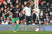 Fulham striker, Moussa Dembele (25) taking on Bristol City defender, Adam Matthews (26) during the Sky Bet Championship match between Fulham and Bristol City at Craven Cottage, London, England on 12 March 2016. Photo by Matthew Redman.