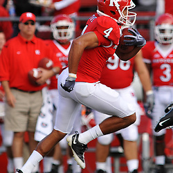 Oct 10, 2009; Piscataway, NJ, USA; Rutgers cornerback David Rowe (4) runs back an interception for a touchdown during first half NCAA college football action between Rutgers and Texas Southern at Rutgers Stadium.
