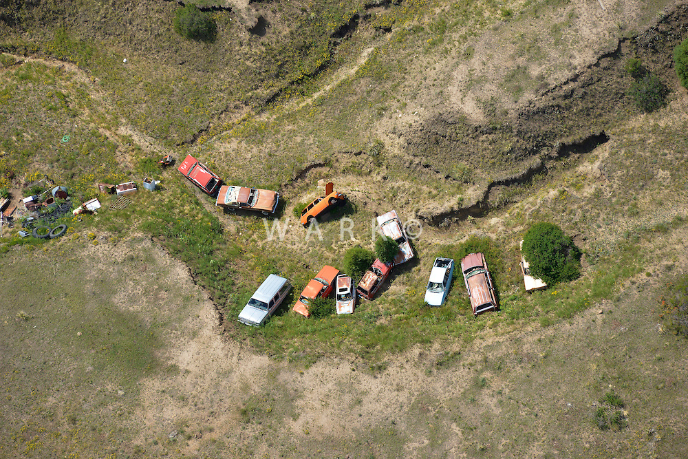 Drainage landfill with car bodies.  East of Black Forest, Colorado.  June 2013.  89903