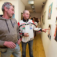 Ultan Queally Lahinch and Michael Moloney Kilfenora looking at artwork by Kewalin Wichajan