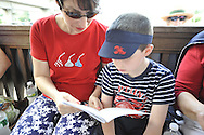 William Heaney, 7, and Mom Juliette Fernan of Merrick participate in the annual reading of the Declaration of Independence on Wednesday, July 4, 2012 hosted by Historical Society of the Merricks, Long Island, New York, USA. Volunteers each read one line from the historic document in this Long Island tradition.