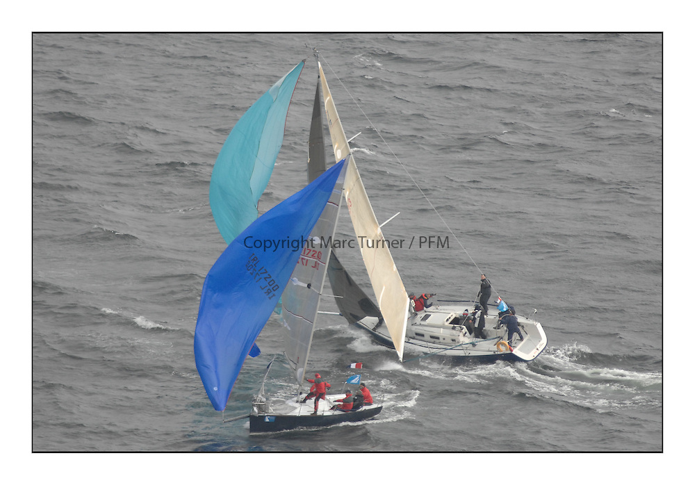 The Brewin Dolphin Scottish Series, Tarbert Loch Fyne...IRL17200 Antix Beag Royal Cork YC Anthony O'Leary.broaches in front of GBR66R Christie Cancer Care J109  RStGYC Hyland / Biggs.