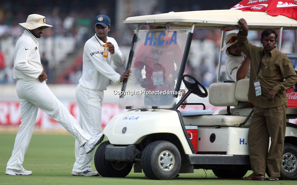 Indian Playes Harbhajan Singh And Pragiyan Ojha In A Drink Break During The @nd Test Match India vs New Zealand Played at Rajiv Gandhi International Stadium, Uppal, Hyderabad 13, November 2010 (5-day match)